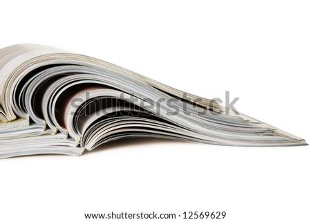Stack of open magazines isolated on white - stock photo