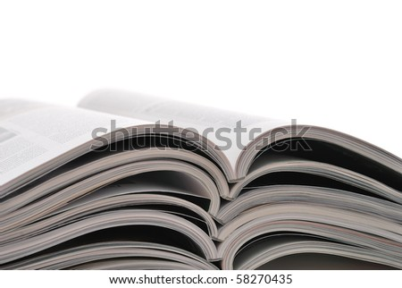 Stack of open magazines on white background.