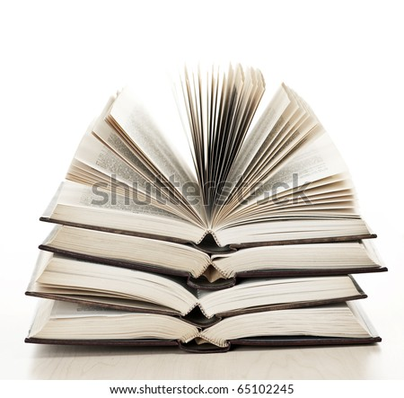 Stack of open old fanned hardcover leather bound books - stock photo