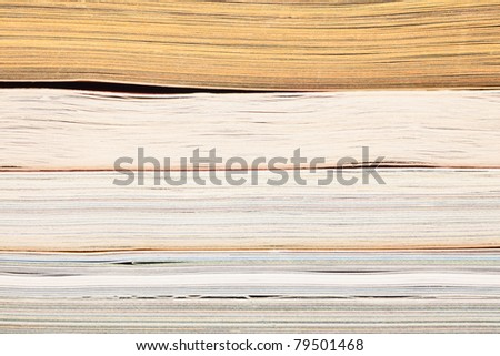 stack of opened magazines background texture - stock photo