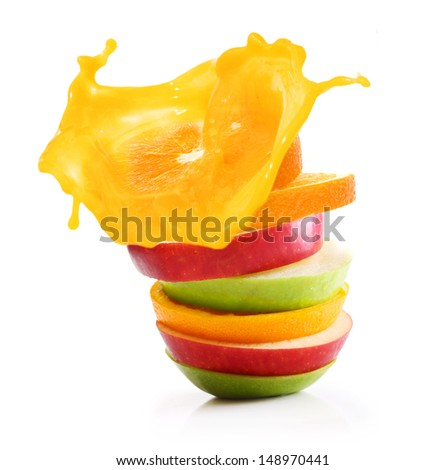 Stack of orange fruit and apples slices with juice splash. - stock photo