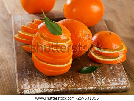 Stack of orange slices on  wooden table.  - stock photo
