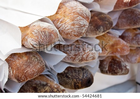 Stack of organic baguettes at the local farmers market - stock photo