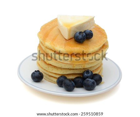 stack of pancake with cheese and blueberries isolated on white  - stock photo
