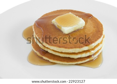 Stack of pancakes with butter and syrup on a plate - stock photo