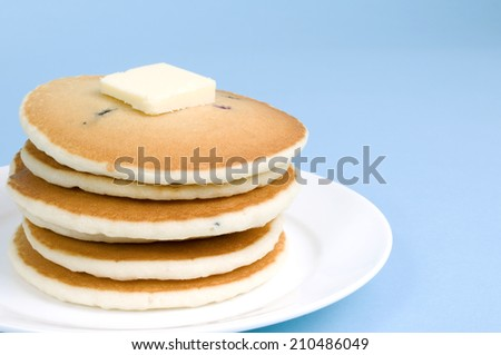 Stack of pancakes with butter but without maple syrup - stock photo
