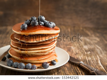 Stack of pancakes with fresh blueberry and maple syrup - stock photo