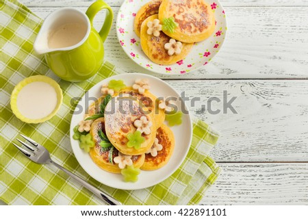 Stack of pancakes with fresh fruits on wooden background. - stock photo