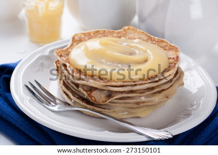 Stack of pancakes with homemade lime curd. Selective focus - stock photo
