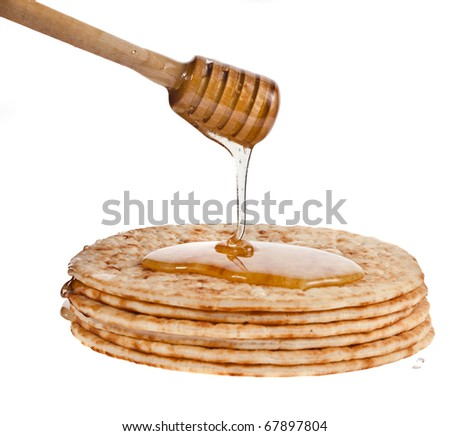 Stack of pancakes with honey isolated on white - stock photo
