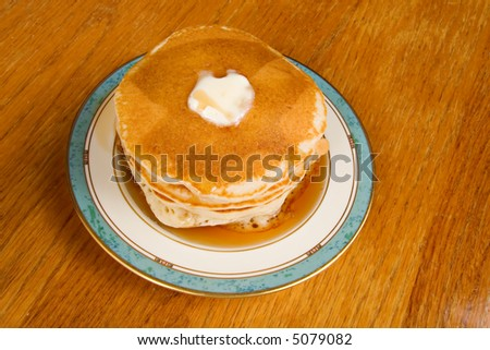 Stack of pancakes with maple syrup - stock photo