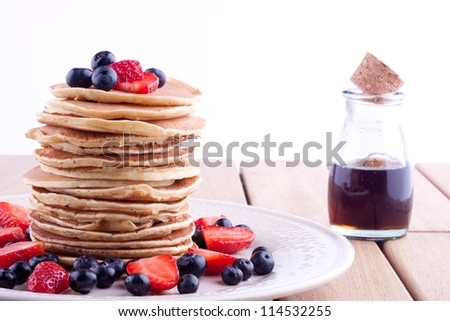 stack of pancakes with strawberry and blueberry - stock photo