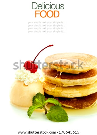 Stack of pancakes with syrup and ice cream. - stock photo