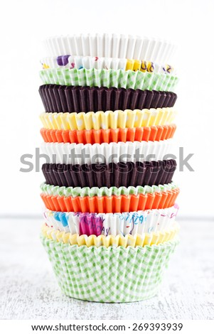 stack of paper baking cups for muffins and cupcakes - stock photo