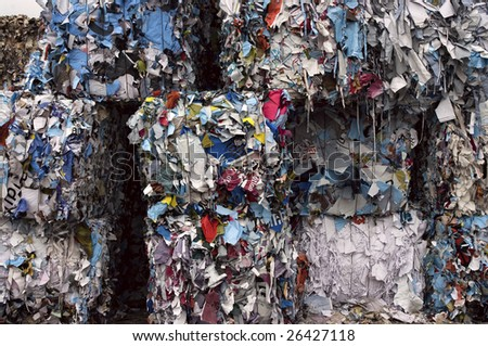 Stack of paper bales for recycling - stock photo