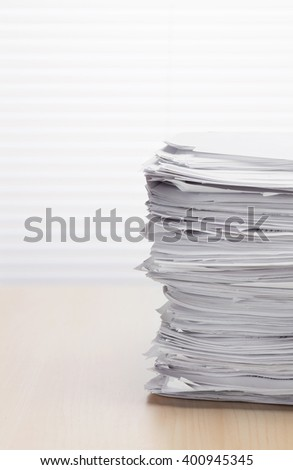 Stack of paper documents on office table - stock photo
