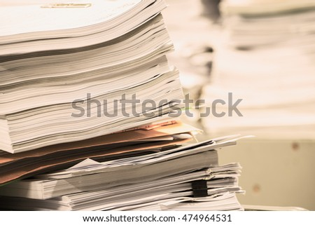 Stack of paper in the office and more work