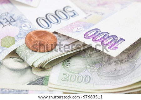 stack of paper money and coins