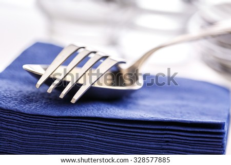 Stack of paper napkins with spoon and fork
