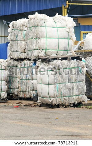 Stack of paper waste at recycling plant isolated recyling factory