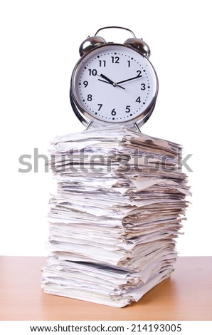 Stack of papers and clock isolated on white - stock photo