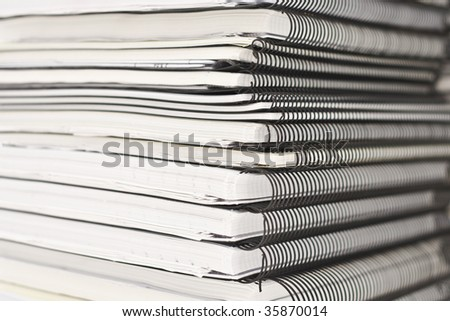 Stack of papers on white background close up - stock photo