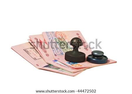 stack of passports and stamp isolated on white - stock photo