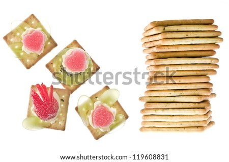 Stack of peanut butter craker with canapes against a white background ...