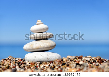 Stack of pebble stones at the beach - stock photo