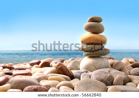 Stack of pebble stones on white background - stock photo