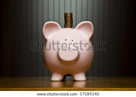 Stack of pennies placed on a piggy bank