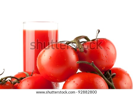 Stack of perfect red tomatoes with juice extreme closeup