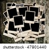 Stack of photo shots on wooden background, sepia - stock photo