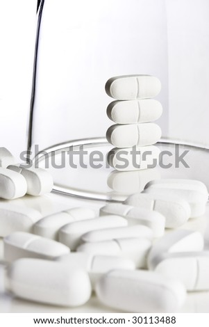 Stack of pills under a glass