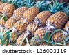 Stack of pinapple fruits - stock photo