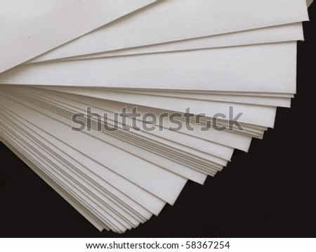 stack of plain paper on black - stock photo