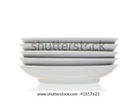 Stack of plain white dinner plates isolated on white background - stock photo