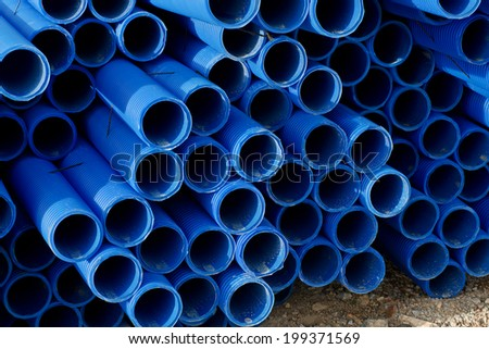 Stack of plastic pipes - stock photo