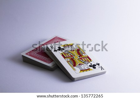 stack of playing cards with king facing up - stock photo