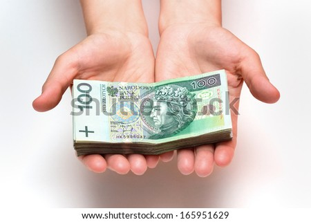 stack of polish banknotes in hands - 100 PLN - on white background - stock photo