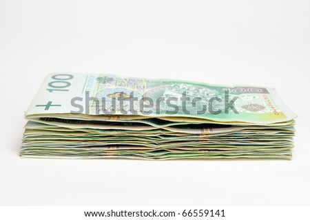 Stack of polish 100 pln banknotes isolated on white background