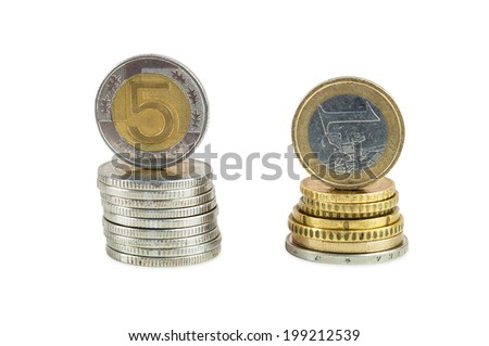 Stack of polish zloty and euro coins isolated on white background with clipping path - stock photo