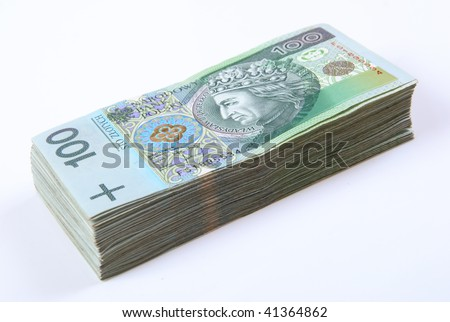 Stack of polish Zloty bills on white background - stock photo