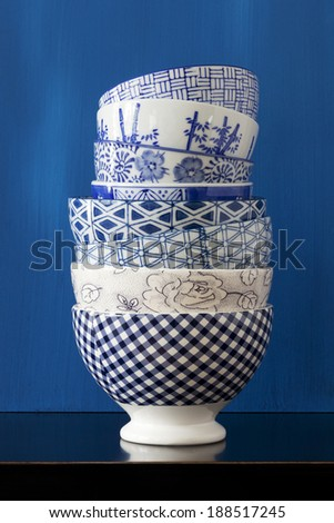 Stack of porcelain bowls with blue and white designs