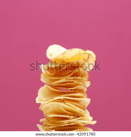 Stack of potato chips - stock photo