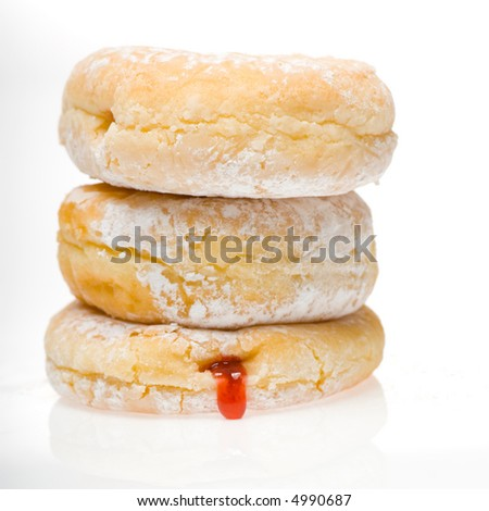 stack of 3 powdered jelly donuts with jelly leaking out - stock photo