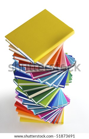Stack of rainbow colored real books in wound formation, top view, isolated on white background - stock photo