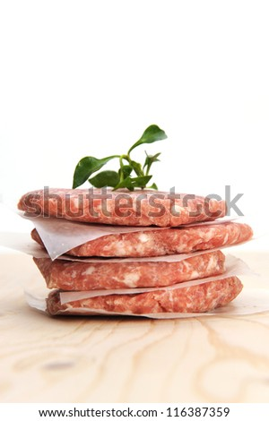 Stack of raw burger on a table - stock photo