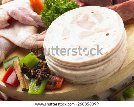 Stack of raw ham slice - stock photo