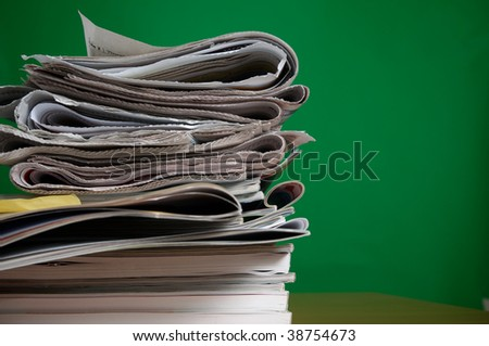 Stack of reading and research magazines and newspaper, a fading way we find information today - stock photo